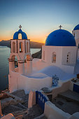 Blue dome of white church in Oia, Santorini, Greece