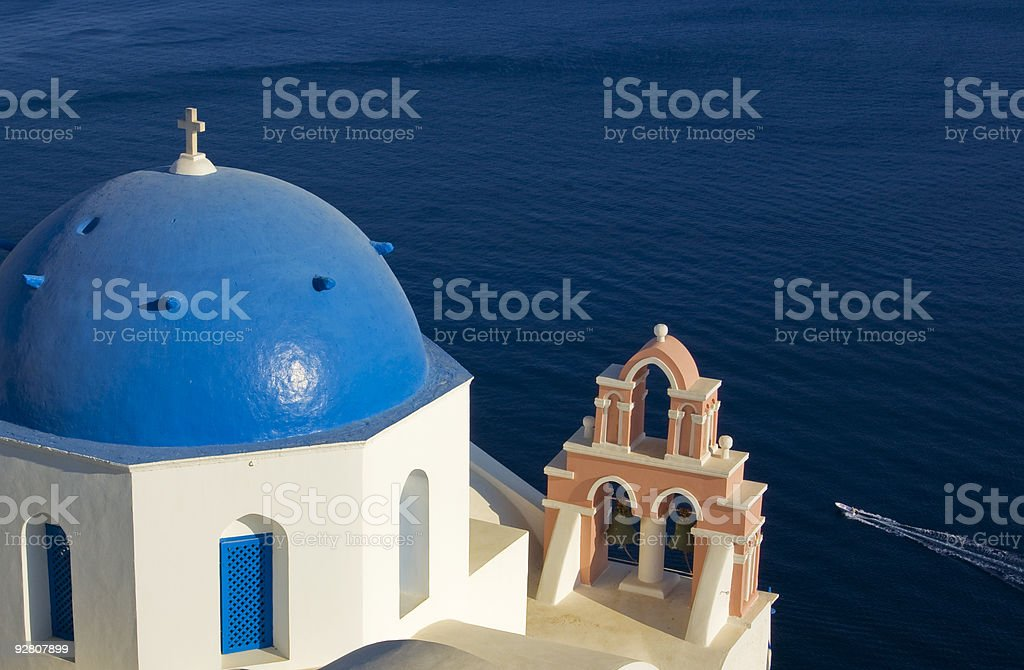Blue Domed Church Overlooking Santorini Caldera royalty-free stock photo