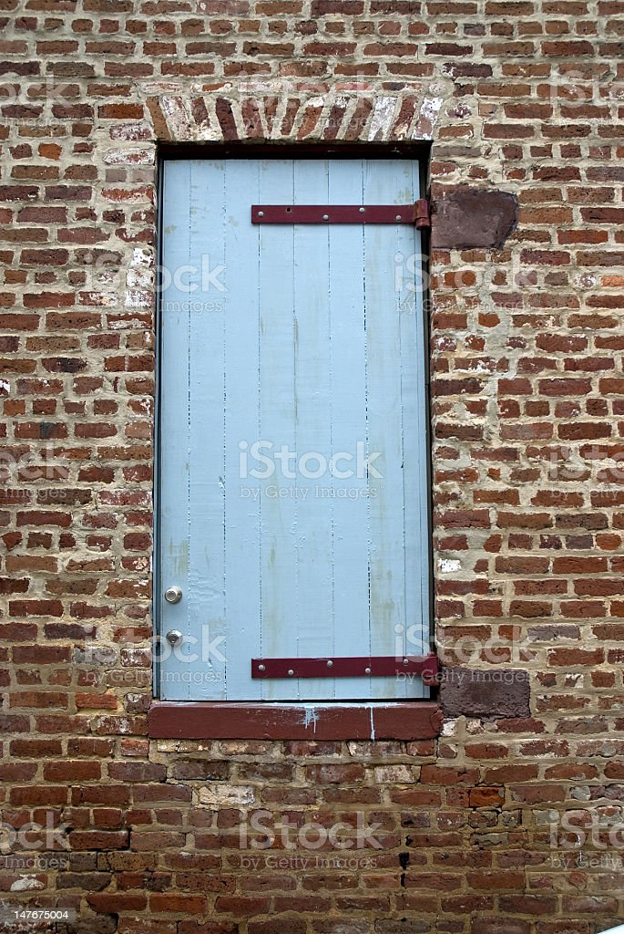 Blue Door and Brick Wall royalty-free stock photo