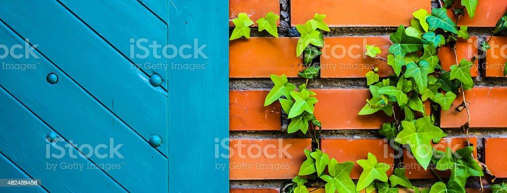 Blue door and brick wall stock photo