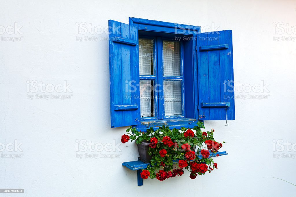 Blue door and window on old house stock photo