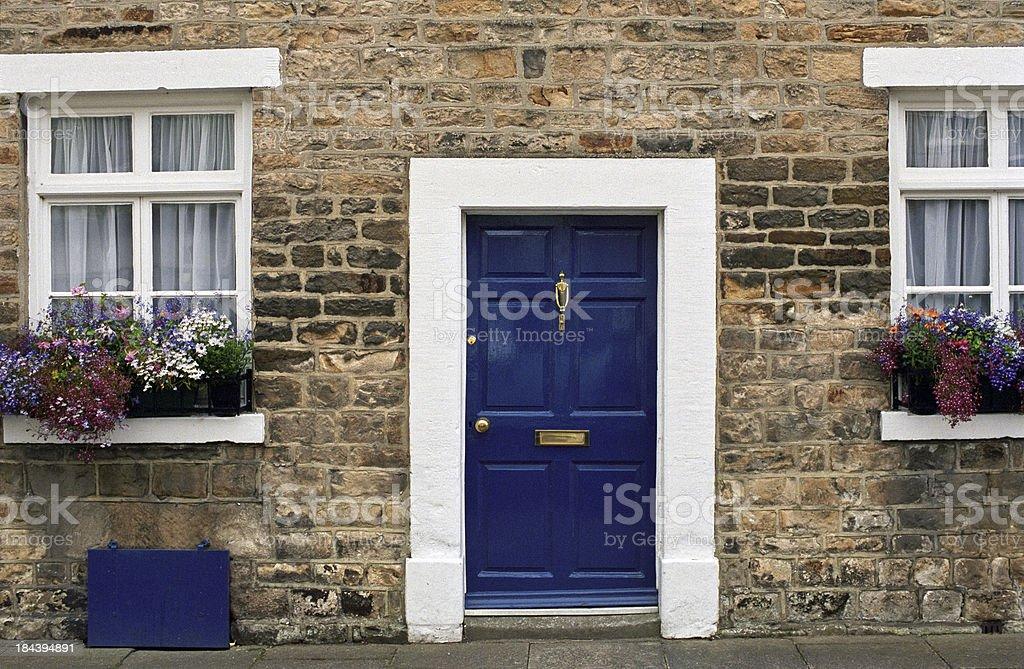 Blue door house stock photo