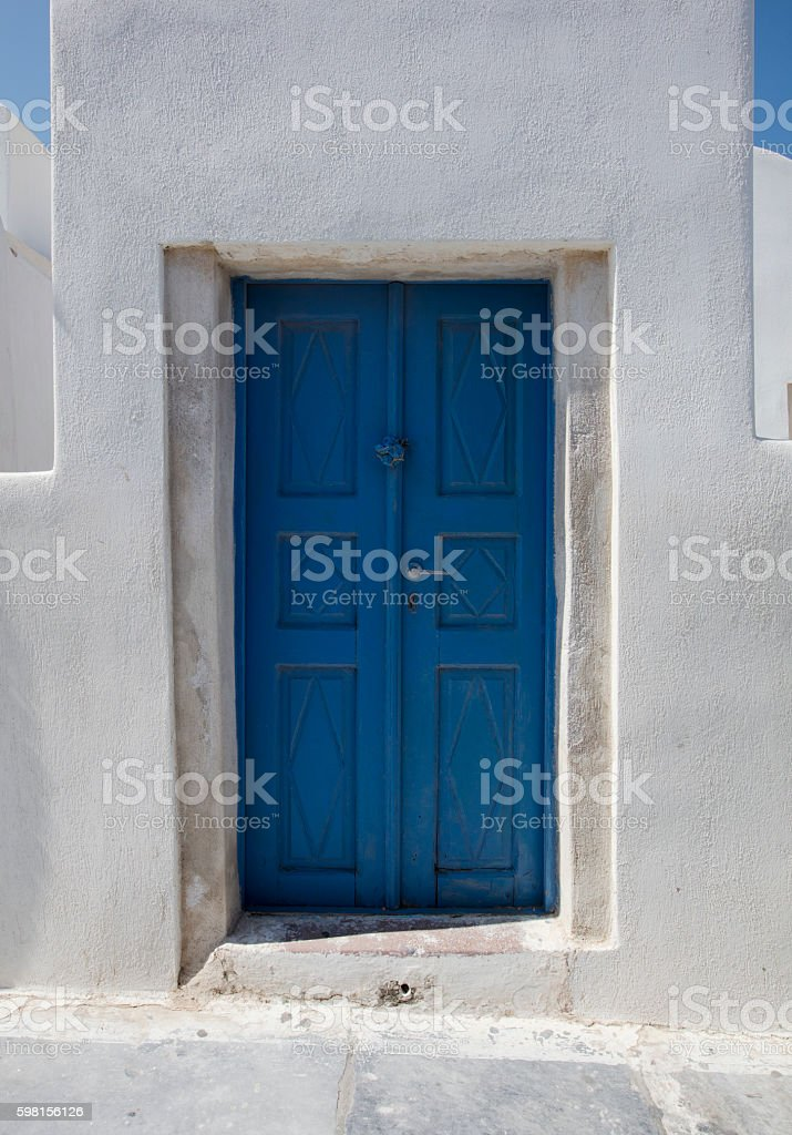 Blue door in Santorini stock photo