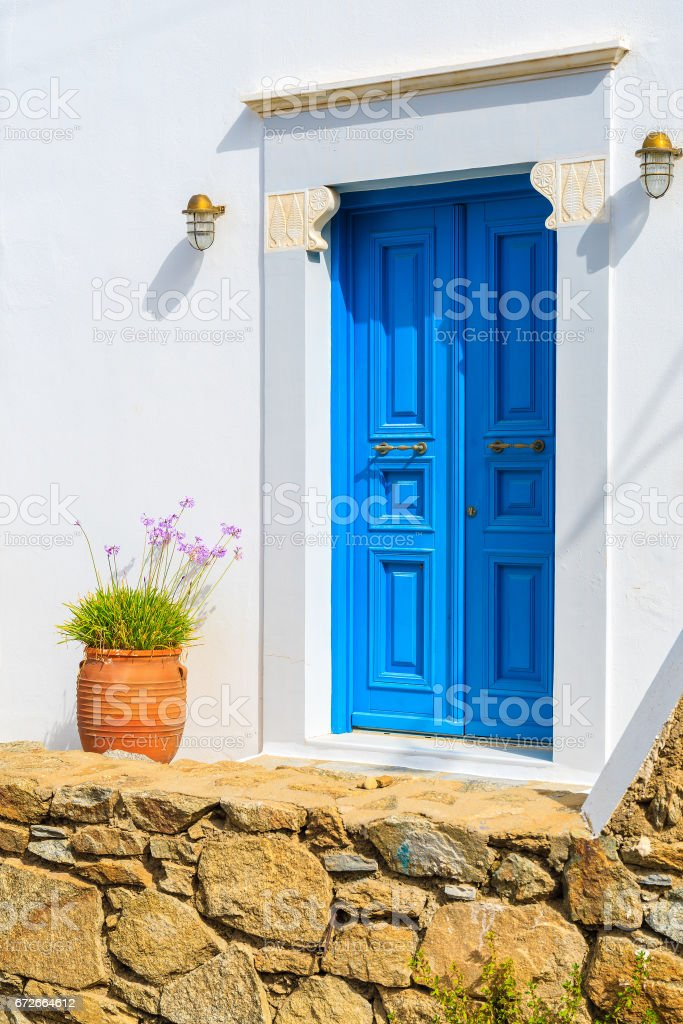 A blue door of a typical white house on Mykonos island, Cyclades, Greece stock photo