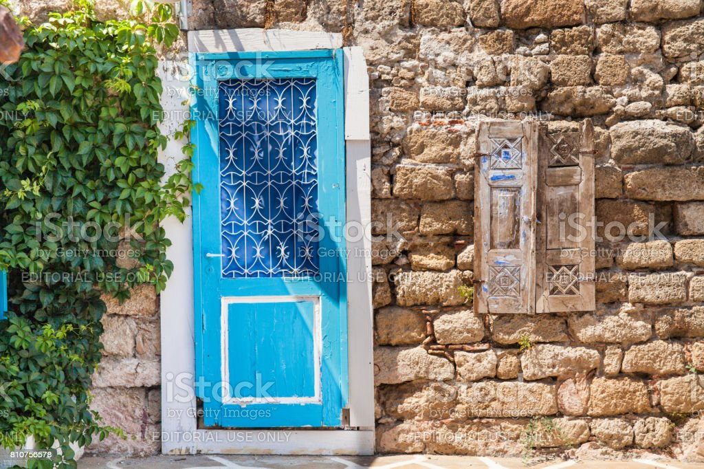 Blue door to House in the city center in the Old Town of the capital of the island of Rhodes. Typical Greek style and building. stock photo