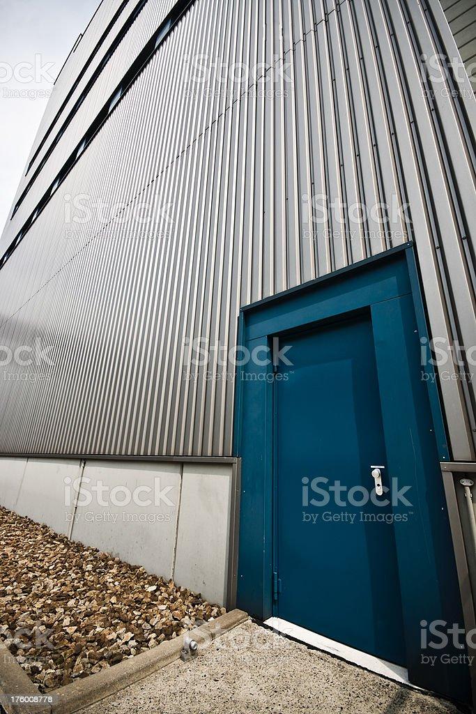 Blue door with metal facade stock photo