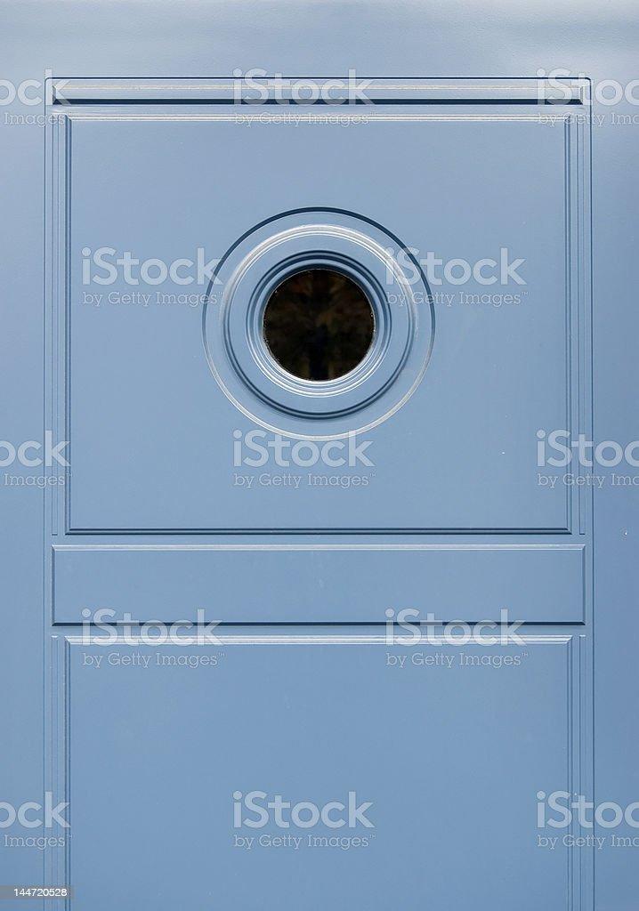 Blue door with round window royalty-free stock photo