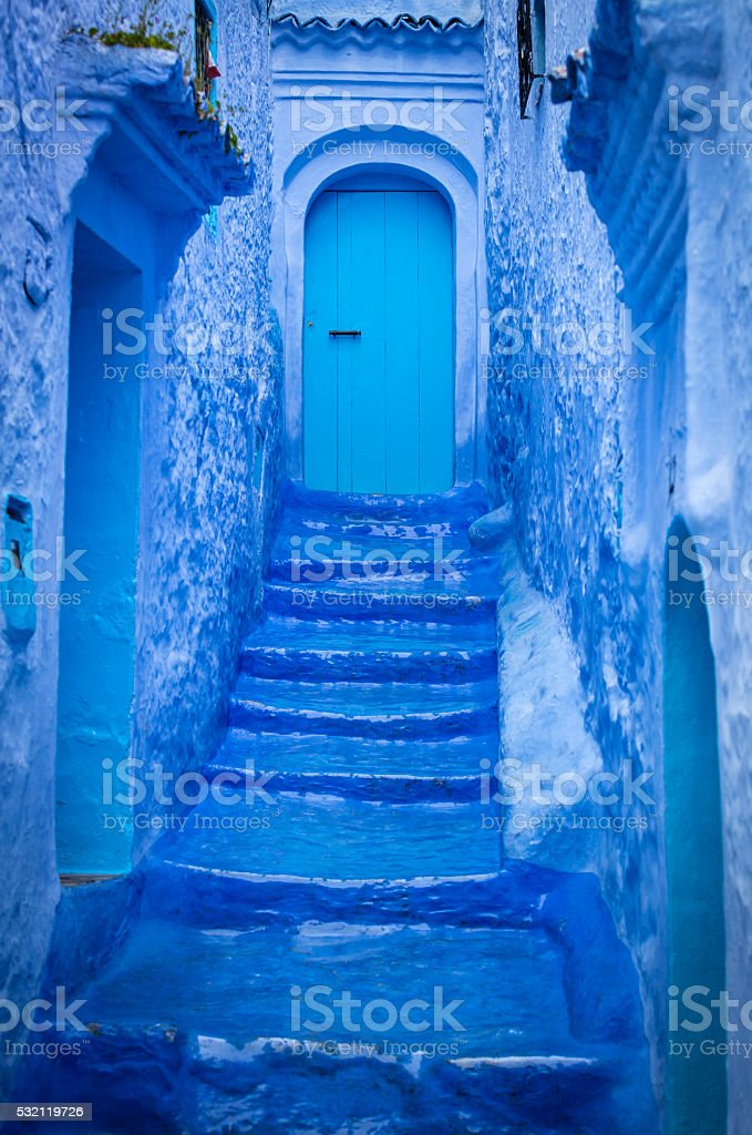 Blue doors and staircase in Chefchaouen, Morocco. stock photo