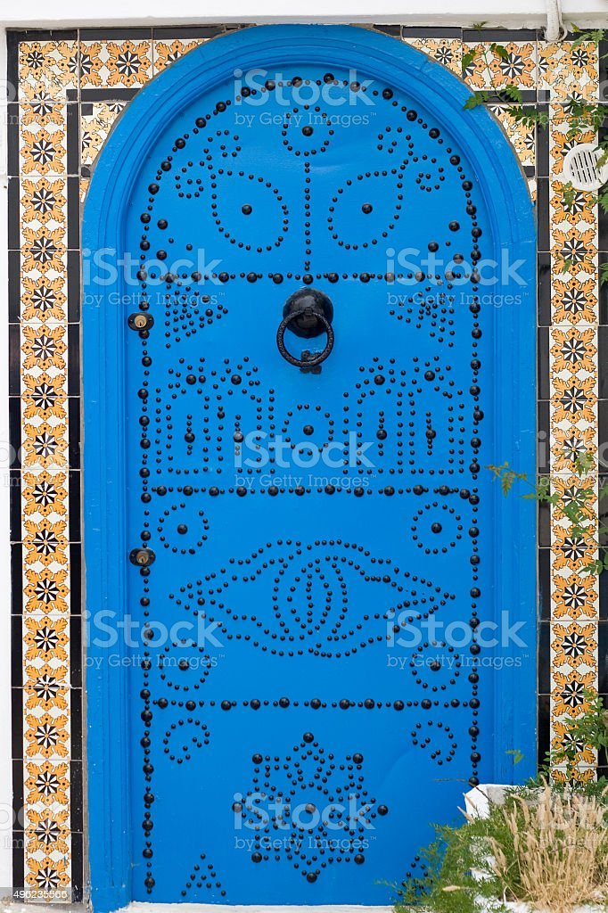 Blue doors and white wall of building in Tunisia stock photo