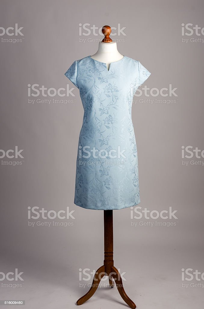 blue dress on a mannequin stock photo