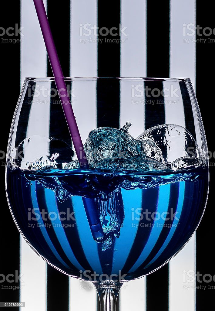 Blue drink with a pink straw stock photo