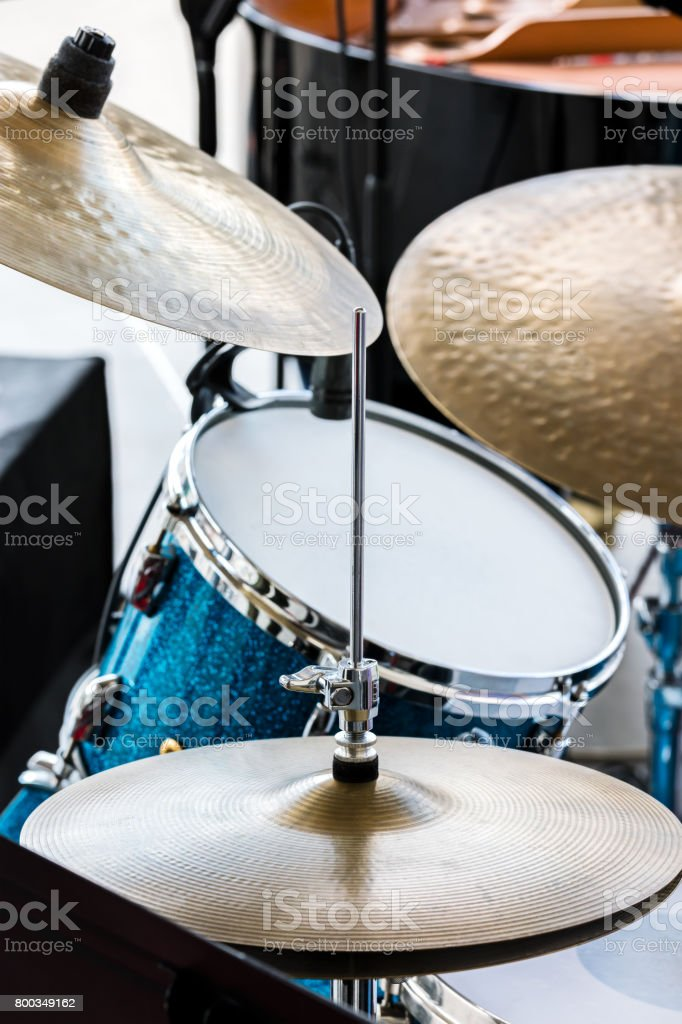 blue drum and copper cymbals standing in street for musical performance stock photo