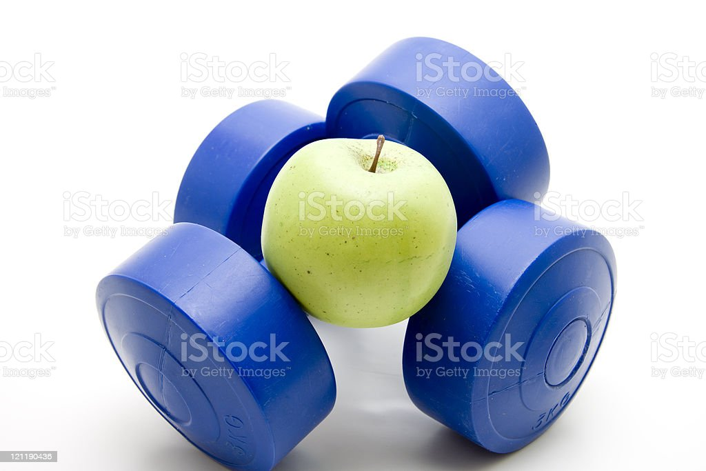 Blue dumbbells with apple stock photo