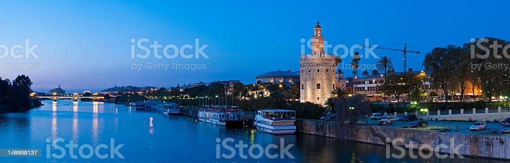 Blue dusk Seville Torre del Oro Guadalquiver stock photo