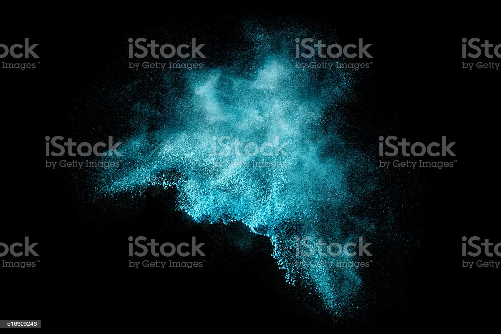Blue Dust Particle Explosion Isolated on Black stock photo