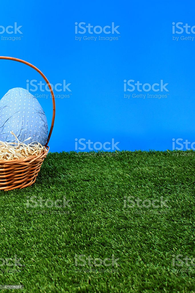 Blue Easter eggs hunt from side royalty-free stock photo