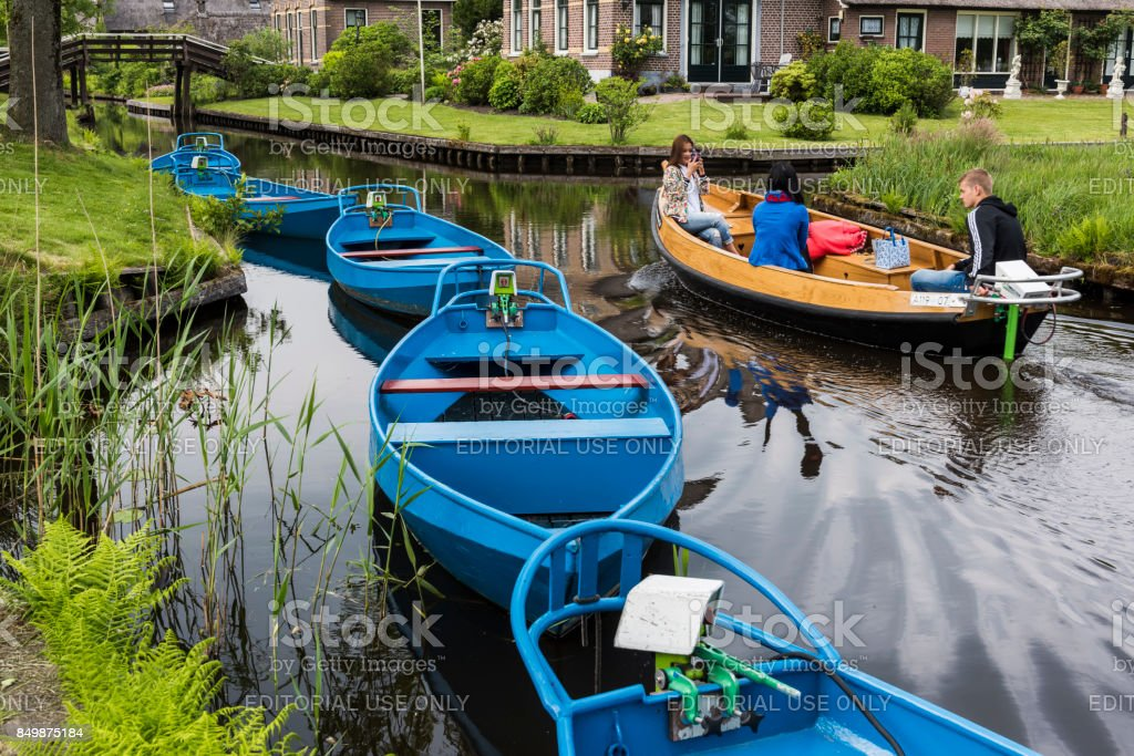 Blue Electric Punter Boats Giethoorn stock photo