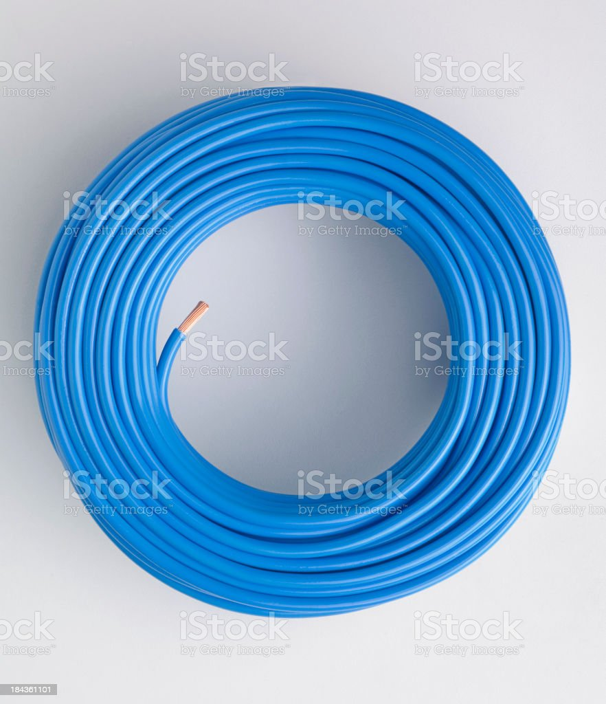 Blue electrical cable in a coil on a white background royalty-free stock photo