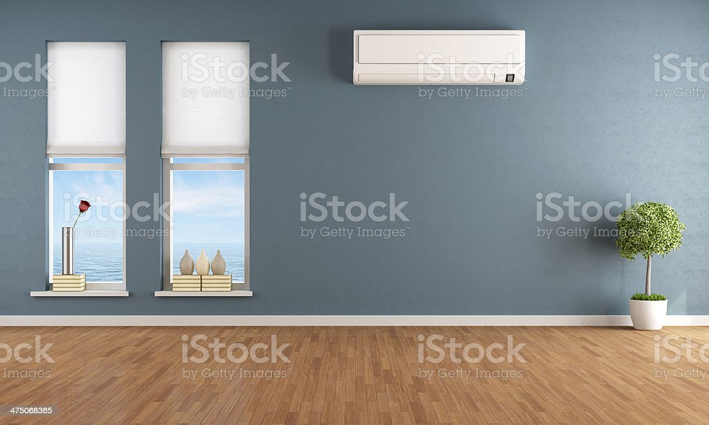 Blue empty room with air conditioner stock photo
