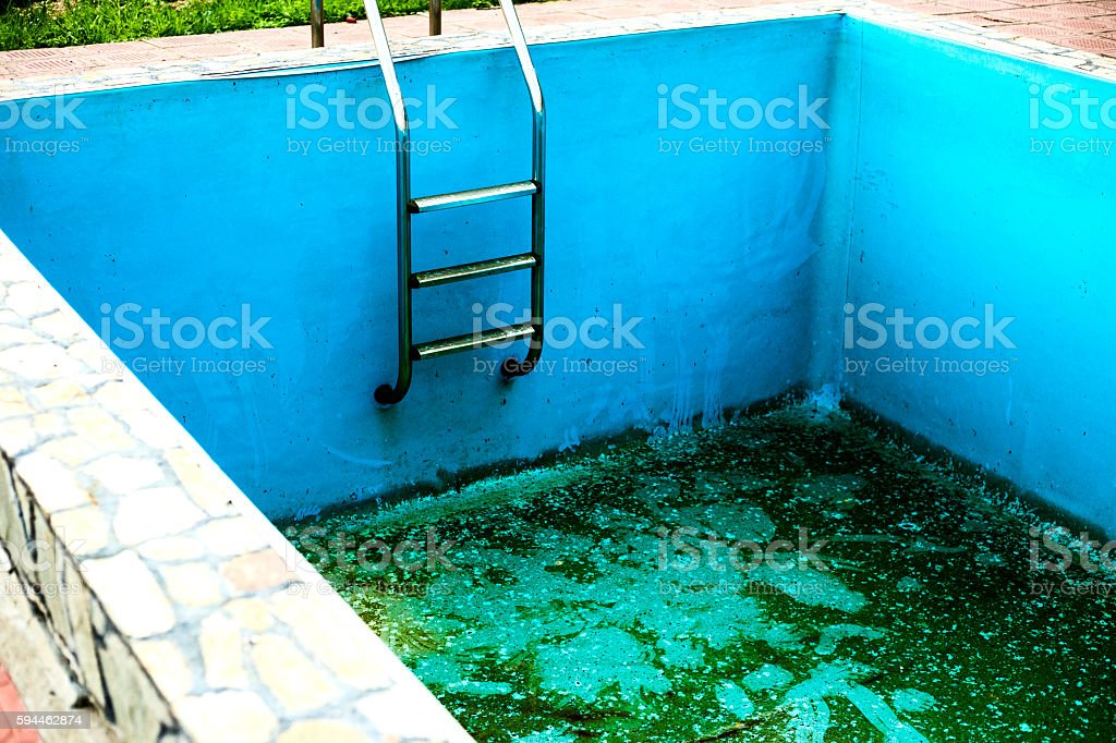 Blue empty swimming pool without water stock photo