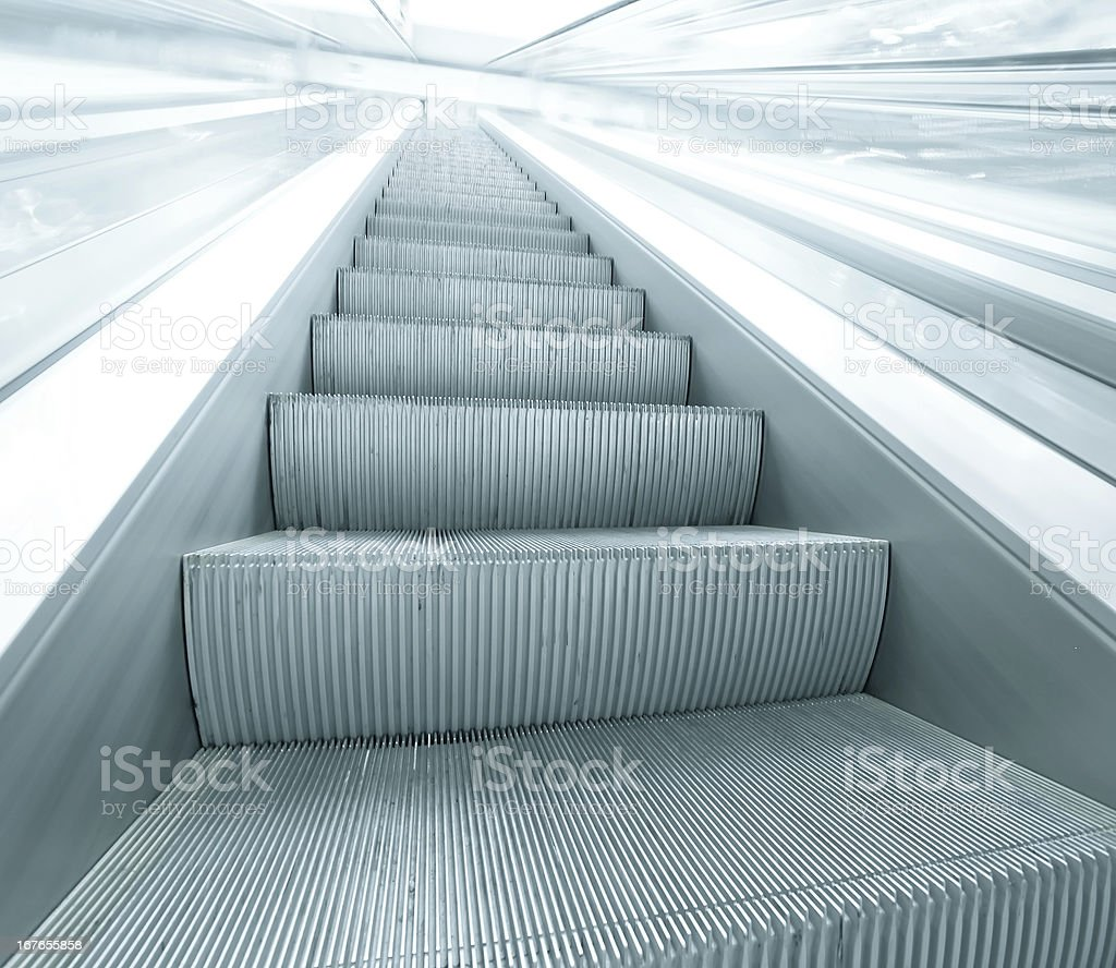 blue escalator in motion royalty-free stock photo