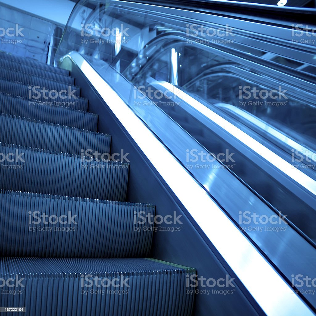 blue escalator royalty-free stock photo