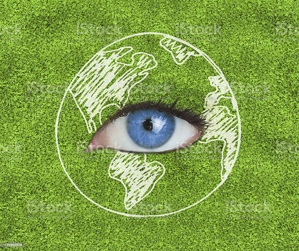Blue eye surrounded by a drawing of the Earth royalty-free stock photo