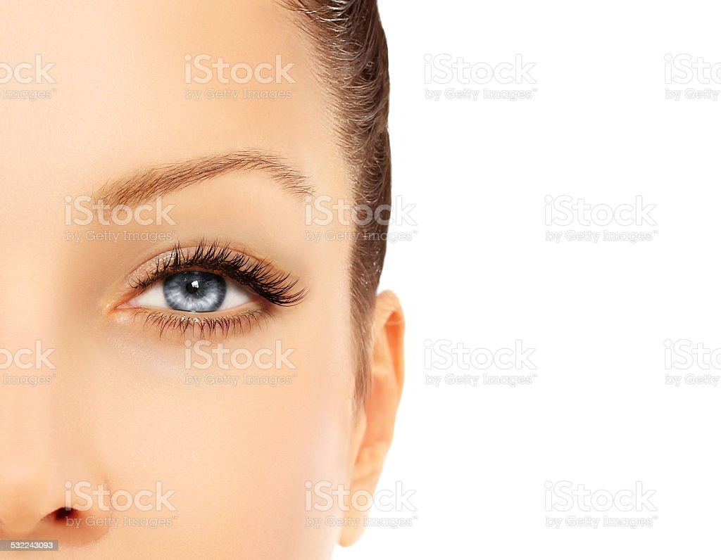 Blue eye with long eyelashes. stock photo