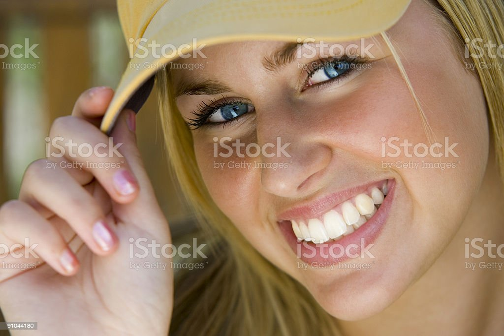 Blue Eyed and Beautiful Blond Girl Smiling In Baseball Cap royalty-free stock photo