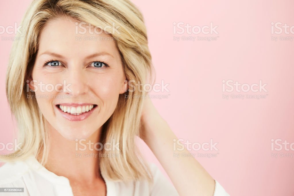Blue eyed blond on pink stock photo