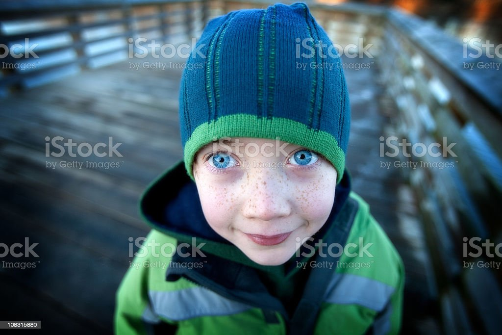 Blue eyed boy with winter toque and jacket. royalty-free stock photo