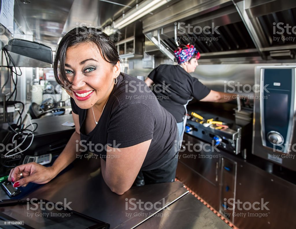 Blue Eyed Cashier On Food Truck stock photo