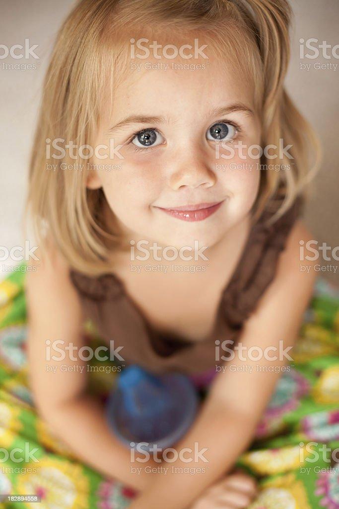 Blue Eyed Girl Looking up at Camera royalty-free stock photo