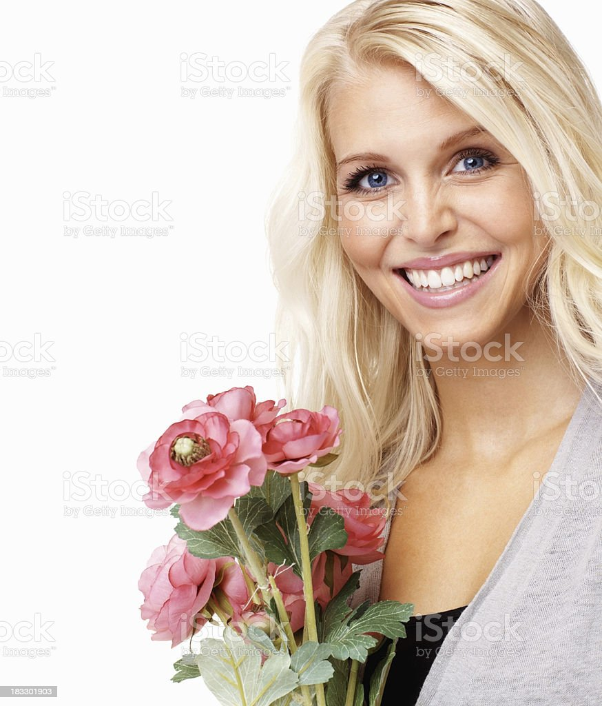 Blue eyed woman with fresh flowers royalty-free stock photo