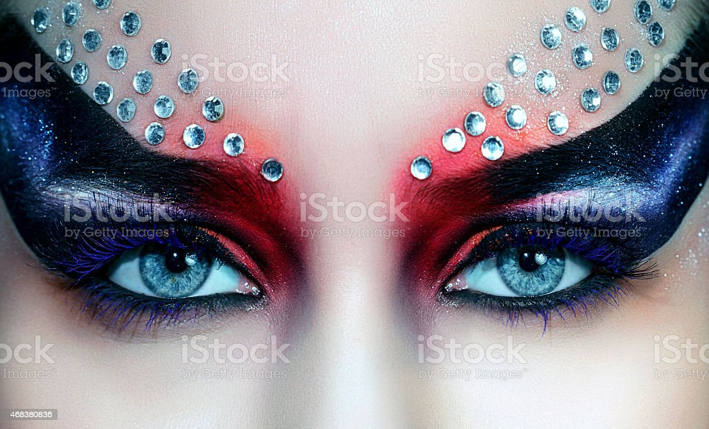 blue eyes and gothic makeup stock photo