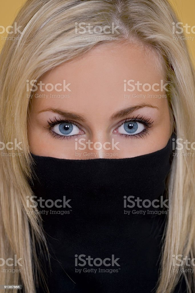 Blue Eyes Only of A Beautiful Young Blond Woman royalty-free stock photo