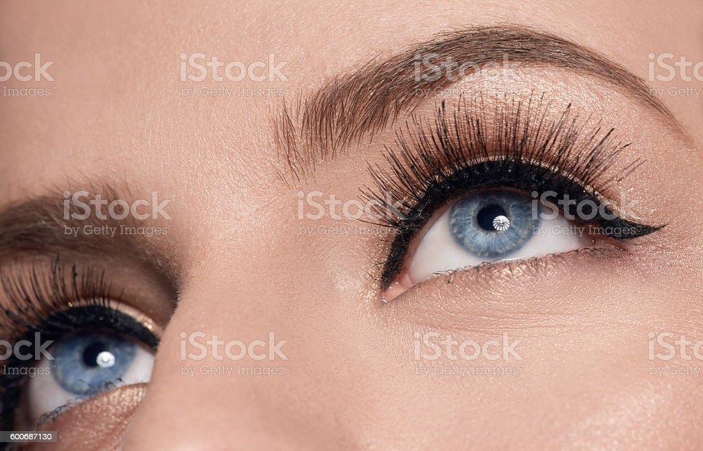 blue eyes with makeup, macro shot stock photo