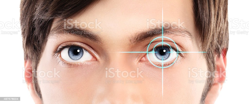 blue eyes young man and laser hologram on her eye stock photo