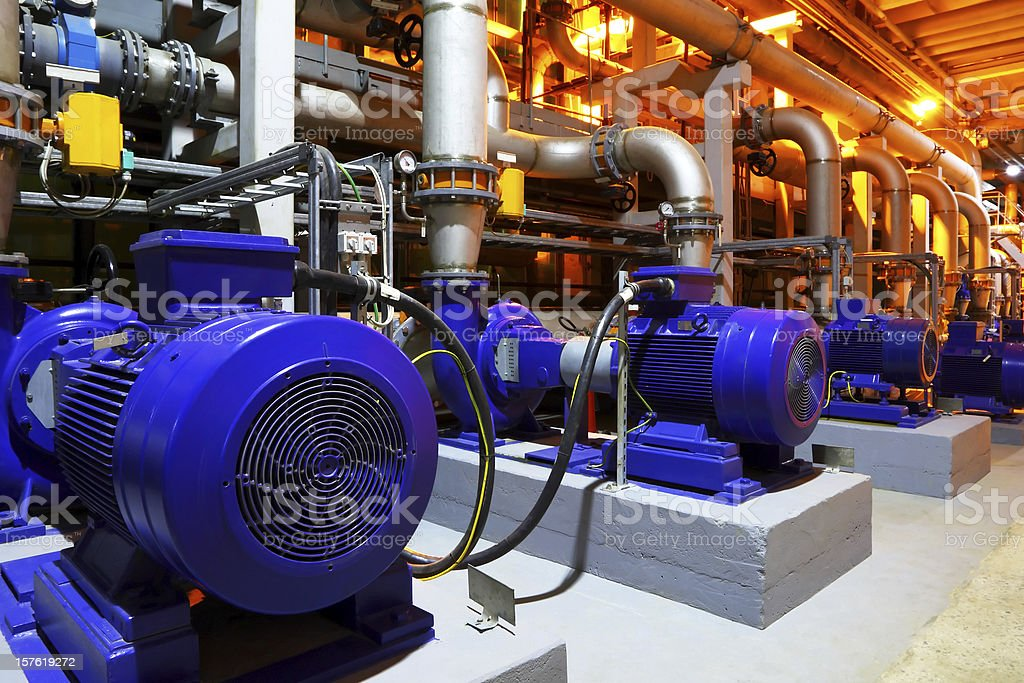 Blue factory equipment in a building stock photo