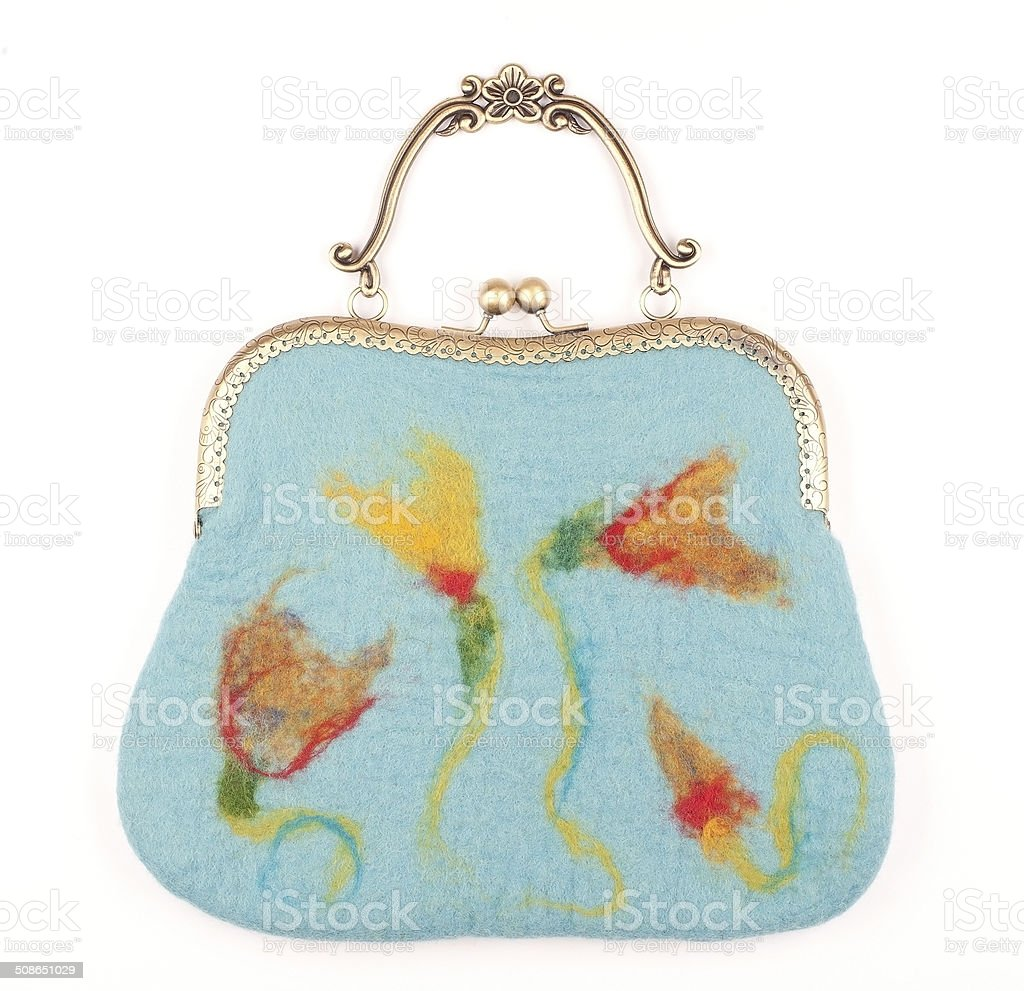 Blue Felted Purse with Metal Handle and Floral Pattern stock photo