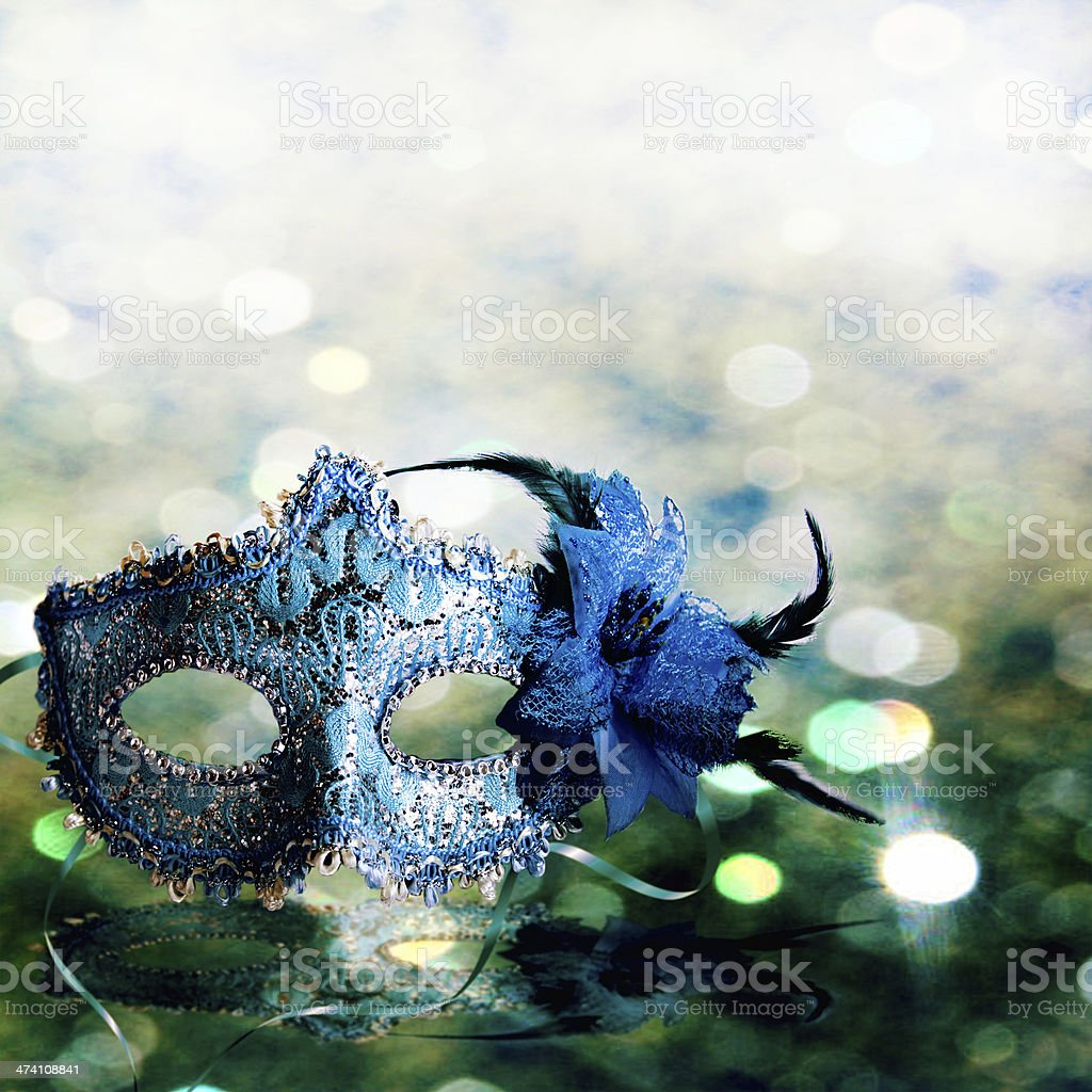 Blue female carnival mask with a glittering background stock photo