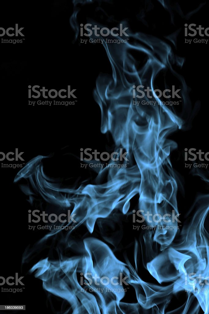 blue fire on black background royalty-free stock photo