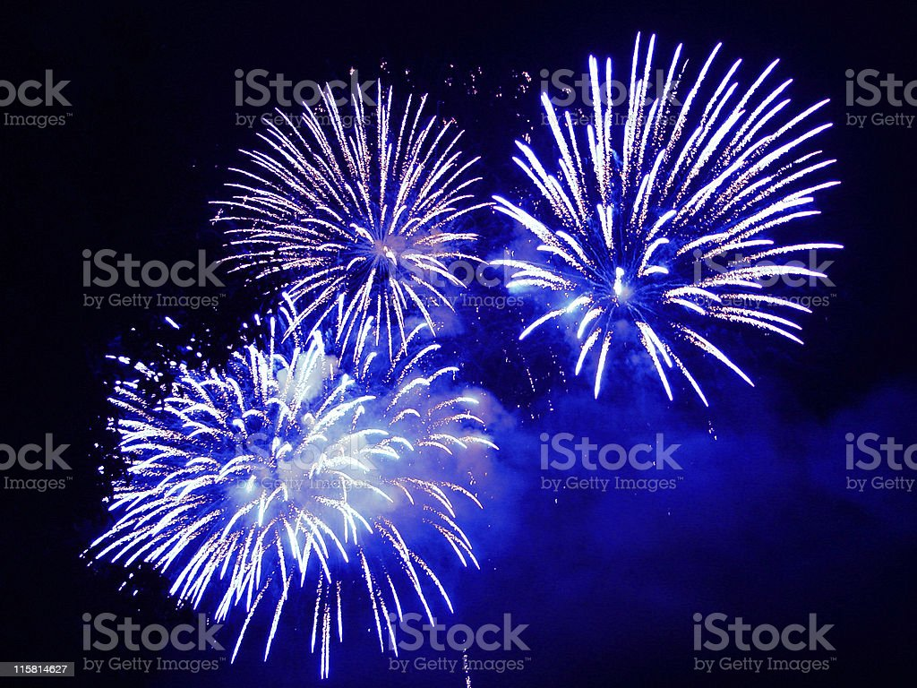 3 blue fireworks in the night sky royalty-free stock photo