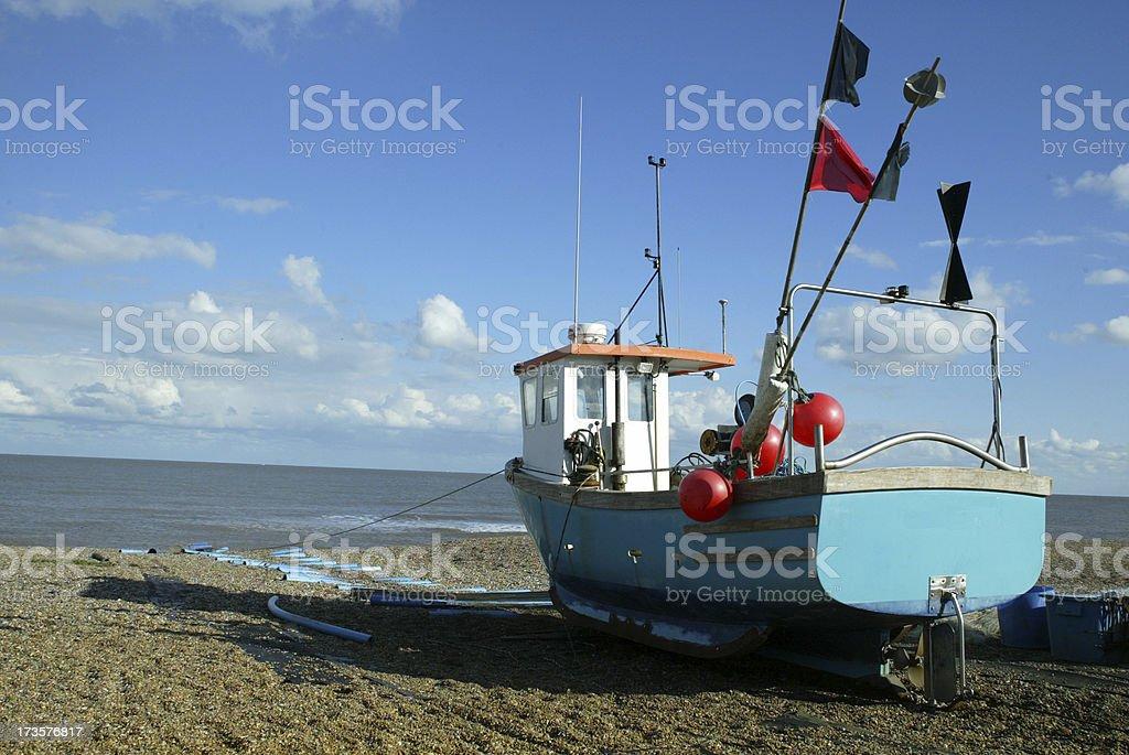 Blue Fishing Boat on beach Aldeburgh Suffolk stock photo