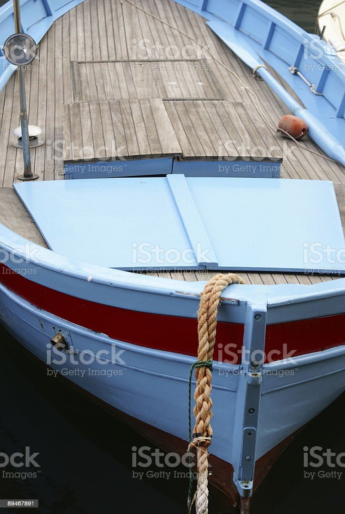 blue fishing boat stock photo