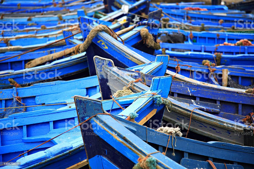 Blue fishing boats Essaouira harbour Morocco stock photo