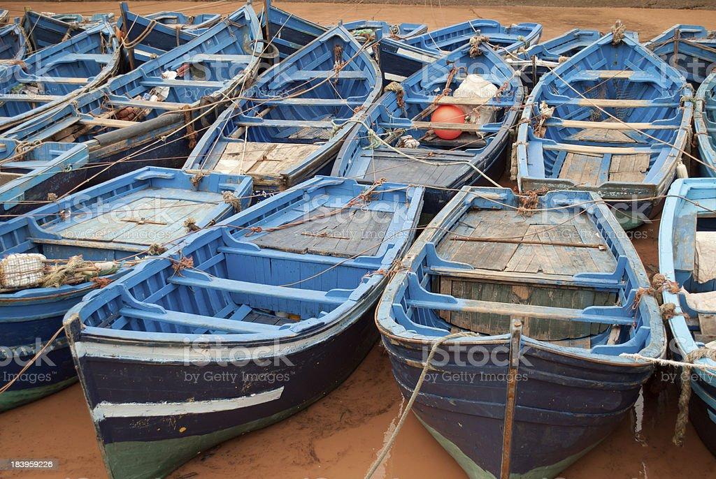 Blue fishing boats in harbor Essaouira Morocco stock photo