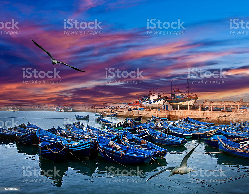 Blue fishing boats on an ocean stock photo