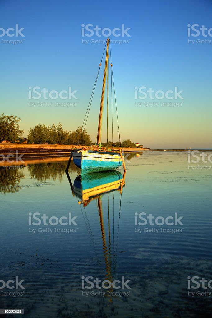 blue fishing sail boat stock photo