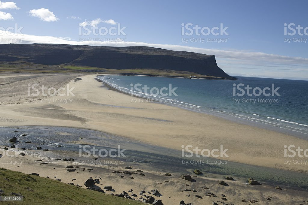 Blue fjord green mountains ocean beach in Iceland stock photo